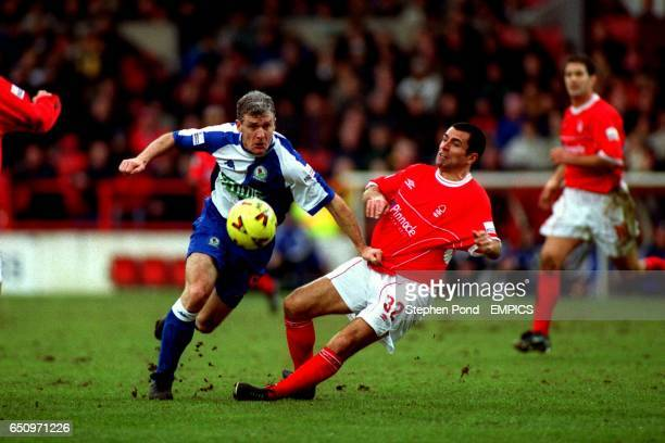 Blackburn Rovers' Mark Hughes pushes Nottingham Forest's Francis Benali to get to the ball