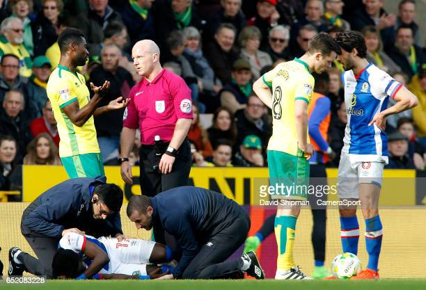 Blackburn Rovers' Marvin Emnes needs treatment after a challenge from Norwich City's Mitchell Dijks during the Sky Bet Championship match between...