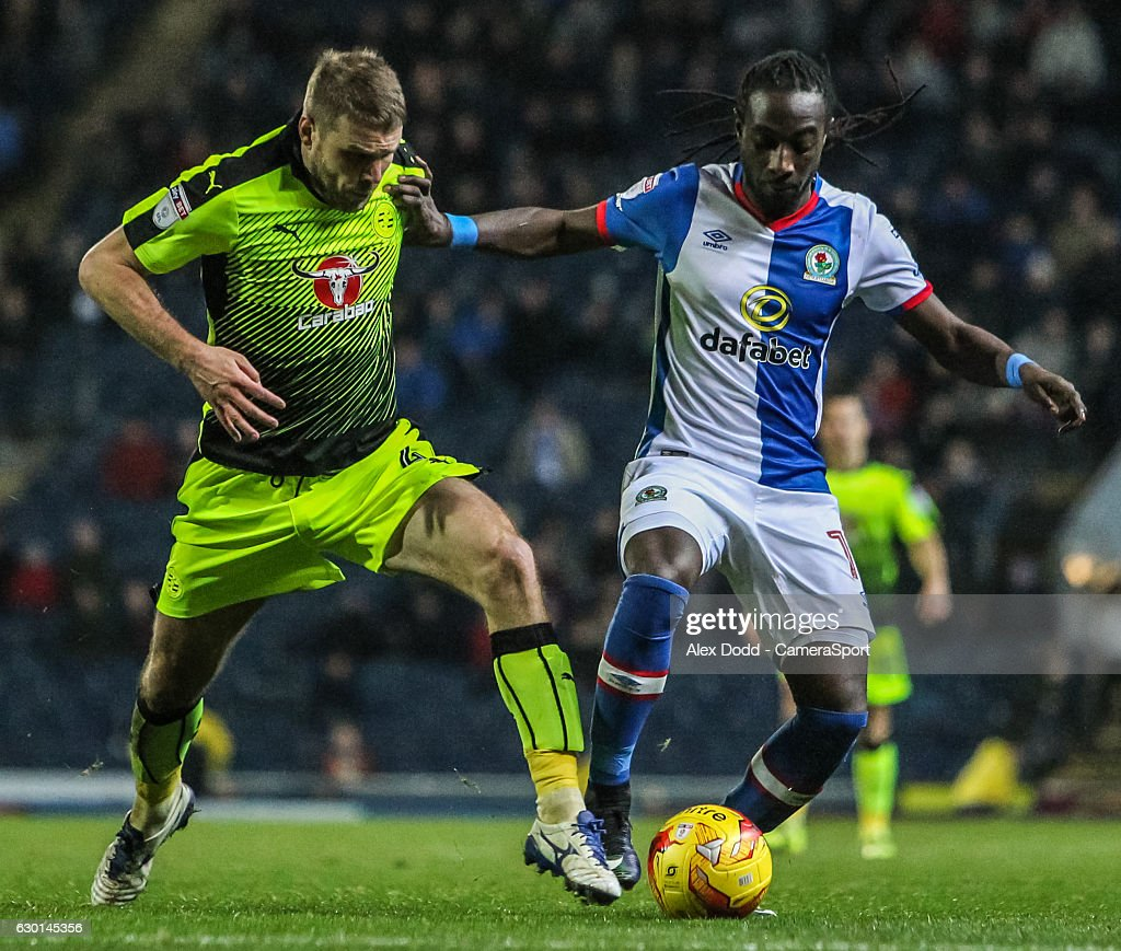 Blackburn Rovers' Marvin Emnes vies for possession with Reading's Joey van den Berg during the Sky Bet Championship match between Blackburn Rovers and Reading at Ewood Park on December 17, 2016 in Blackburn, England.