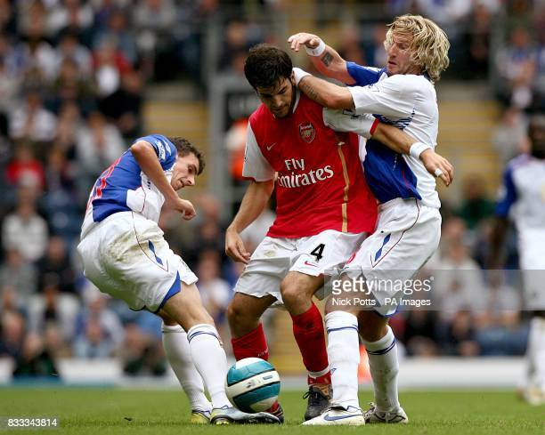 Blackburn Rovers Matt Derbyshire and Robbie Savage put pressure on Arsenal's Francesc Fabregas