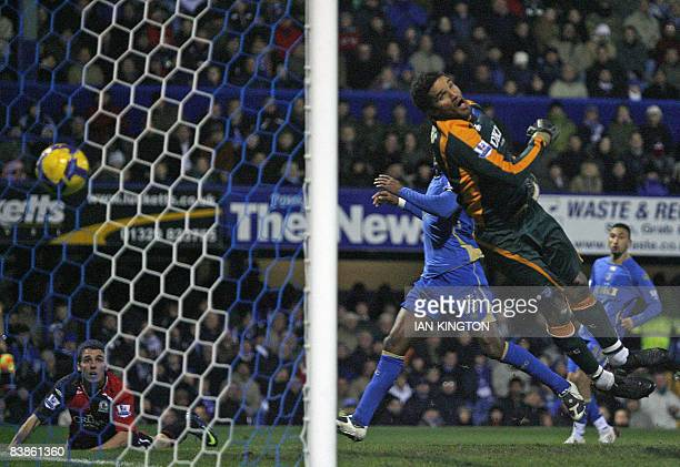 Blackburn Rovers Matt Derbyshire scores his goal beating David James of Portsmouth during a Premier League football match at Fratton Park in...