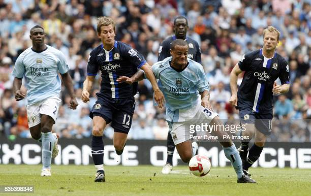 Blackburn Rovers Morten Gamst Pedersen and Manchester City's Vincent Kompany during the Barclays Premier League match at the City of Manchester...
