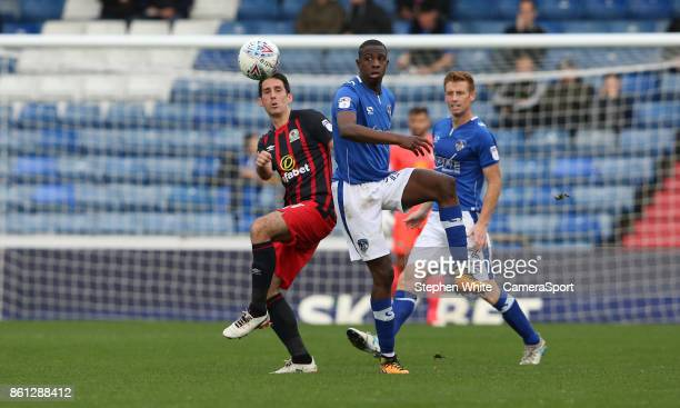 Blackburn Rovers' Peter Whittingham and Oldham Athletic's Ousmane Fané during the Sky Bet League One match between Oldham Athletic and Blackburn...