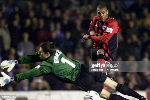 Blackburn Rovers player Marcus Bent shoots at goal but Birmingham City goalkeeper Ian Bennett gets a touch with his legs during their Division One...