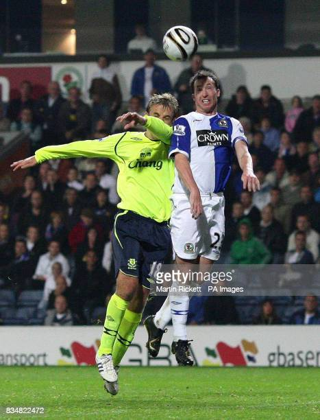 Blackburn Rovers' Robbie Fowler and Everton's Phil Neville battle for the ball during the Carling Cup Third Round match at Ewood Park Blackburn