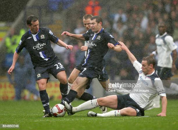 Blackburn Rovers' Robbie Fowler and team mate Brett Emerton battle for the ball with Bolton Wanderers's Kevin Nolan