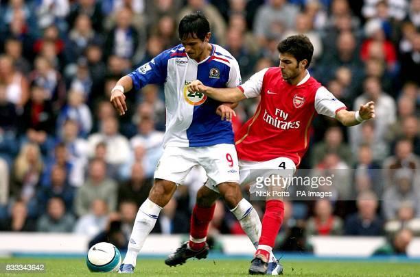 Blackburn Rovers' Roque Santa Cruz and Arsenal's Francesc Fabregas battle for the ball