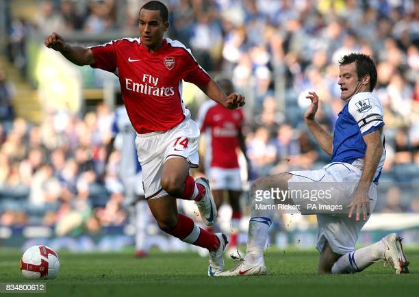 Blackburn Rovers' Ryan Nelsen challenges Arsenal's Theo Walcott as they battle for the ball