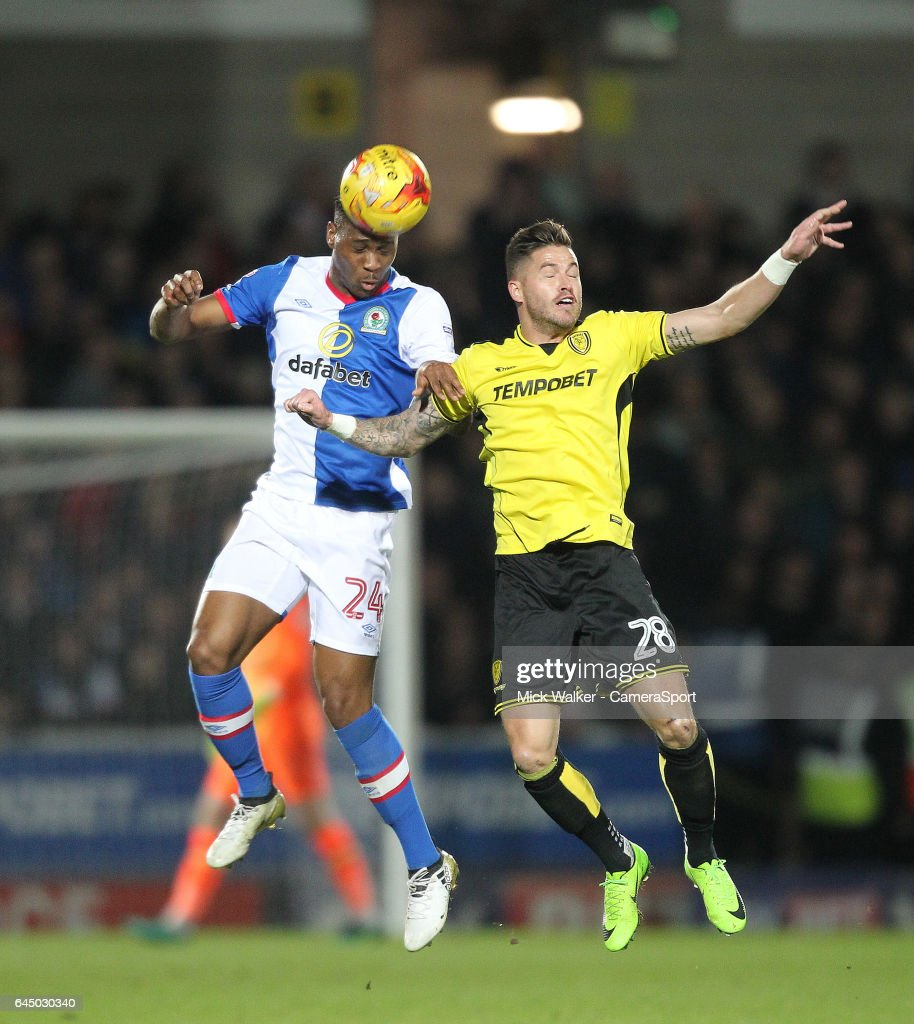 Blackburn Rovers Ryan Nyambe jumps with Burton Albion's Michael Kightly during the Sky Bet Championship match between Burton Albion and Blackburn Rovers at Pirelli Stadium on February 24, 2017 in Burton-upon-Trent, England.