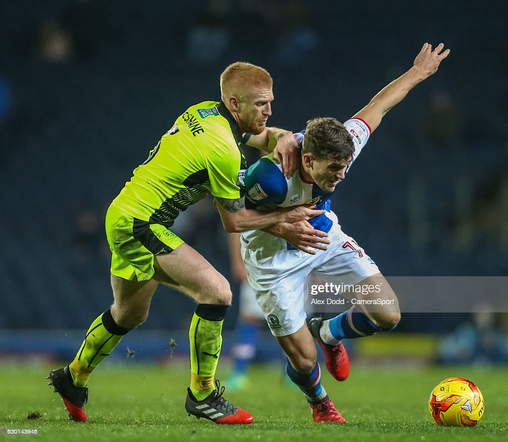 Blackburn Rovers' Sam Gallagher battles with Reading's Paul McShane during the Sky Bet Championship match between Blackburn Rovers and Reading at Ewood Park on December 17, 2016 in Blackburn, England.