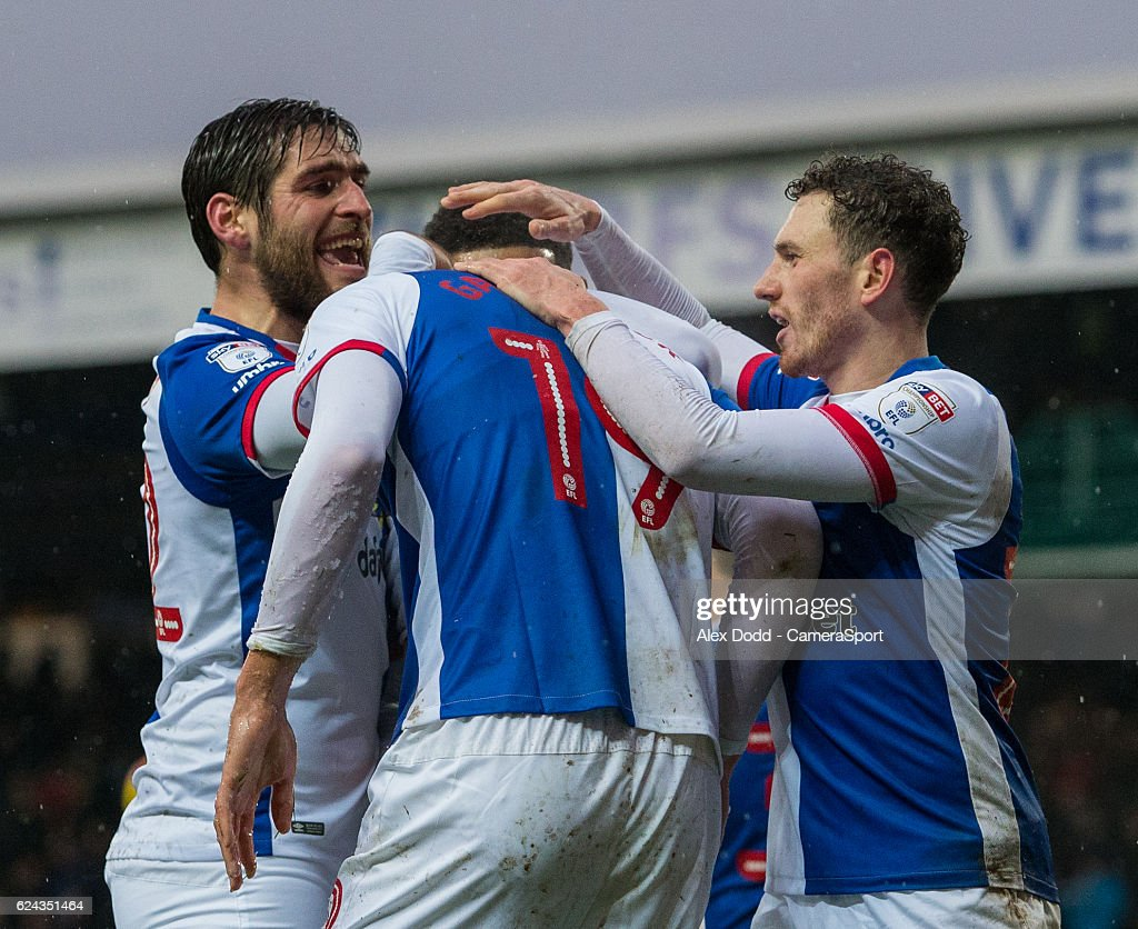 Blackburn Rovers' Sam Gallagher celebrates with teammates after his cross was turned into the net by Brentford's Harlee Dean during the Sky Bet Championship match between Blackburn Rovers and Brentford at Ewood Park on November 19, 2016 in Blackburn, England.