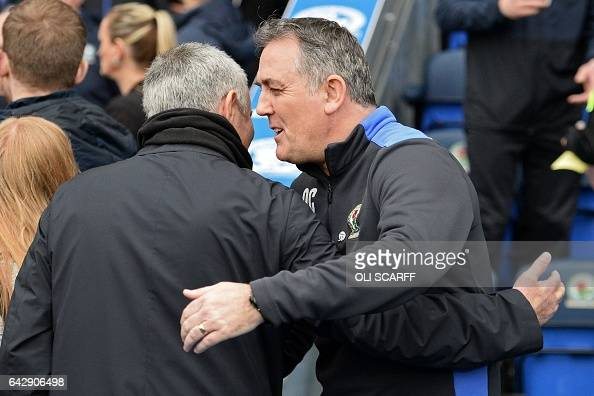 Blackburn Rovers' Scottish manager Owen Coyle greets Manchester United's Portuguese manager Jose Mourinho ahead of the English FA Cup fifth round...