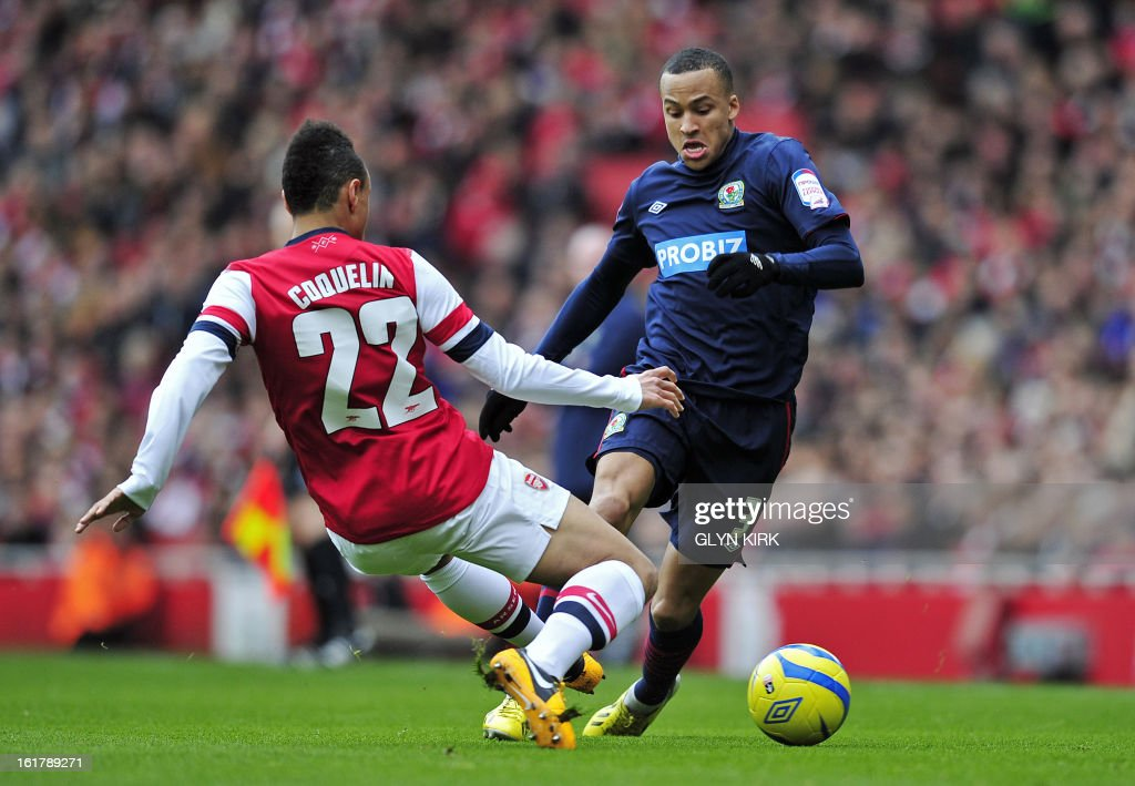 Blackburn Rovers' Swedish defender Martin Olsson (R) vies with Arsenal's French midfielder Francis Coquelin (L) during the English FA Cup fifth round football match between Arsenal and Blackburn Rovers at the Emirates Stadium in London on February 16, 2013. USE. No use with unauthorized audio, video, data, fixture lists, club/league logos or 'live' services. Online in-match use limited to 45 images, no video emulation. No use in betting, games or single club/league/player publications.