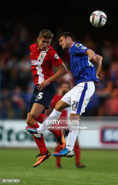 Blackburn Rover's Tom Cairney and Carlisle United's James Berrett during the Capital One Cup First Round match at Brunton Park Carlisle