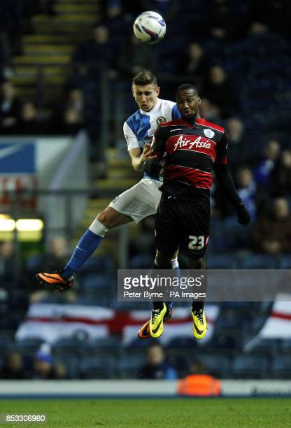 Blackburn Rovers' Tom Cairney and Queens Park Rangers David Hoilett battle for the ball during the Sky Bet Championship match at Ewood Park Blackburn