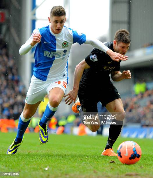 Blackburn Rovers Tom Cairney battles for the ball with Manchester City's James Milner during the FA Cup Third Round match at Ewood Park Blackburn