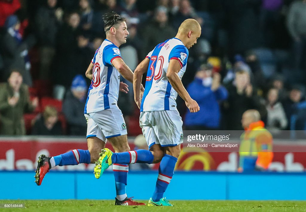 Blackburn Rovers' Wes Brown gets a congratulatory hand slap from Ben Marshall after levelling the score 2-2 during the Sky Bet Championship match between Blackburn Rovers and Reading at Ewood Park on December 17, 2016 in Blackburn, England.
