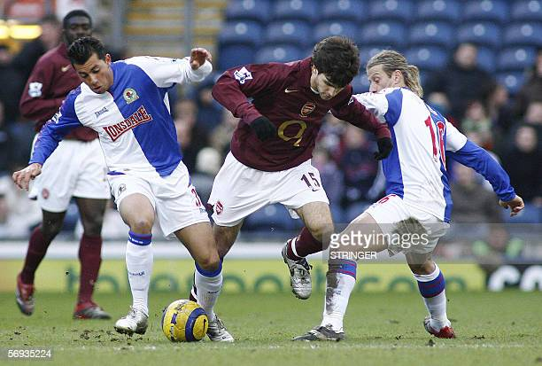 Blackburn Rover's Sergio Peter and Tugay tackle Arsenal's Cesc Fabregas during their English Premiership soccer match at Ewood Park in Blackburn 25...
