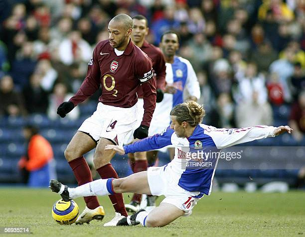Blackburn Rover's Tugay tackles Arsenal's Thierry Henry during their English Premiership soccer match at Ewood Park in Blackburn 25 February 2006 AFP...