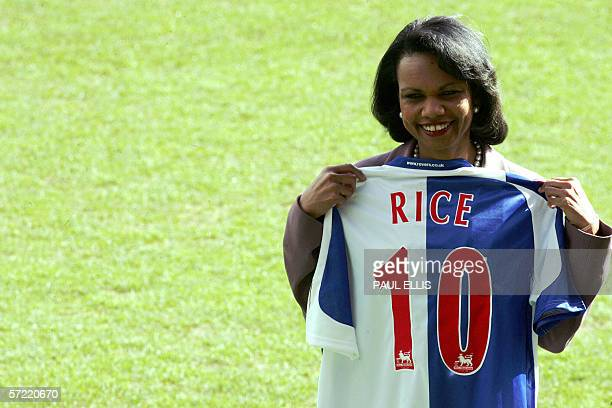US Secretary of State Condoleezza Rice holds a Blackburn Rovers football team shirt before making a Chatham House lecture at Blackbrurn Rovers' Ewood...