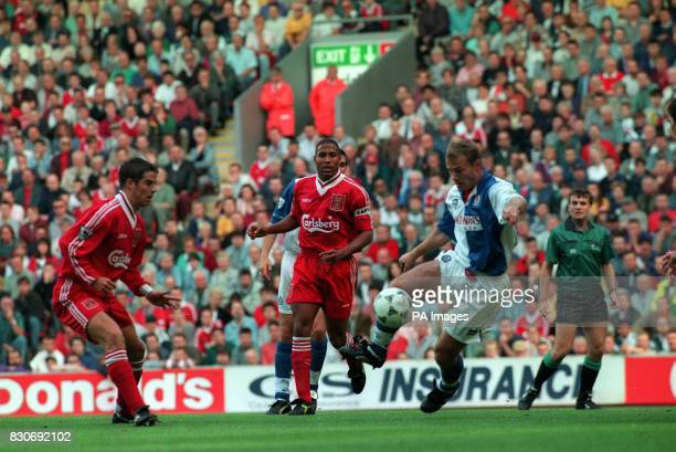 Blackburn's Alan Shearer is confronted by Liverpool's Jamie Redknapp and John Barnes during their Premier League game at Anfield