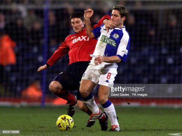 Blackburn's David Dunn is challenged by Jonathan Macken of Preston during the nationwide First Division game at Ewood Park Blackburn