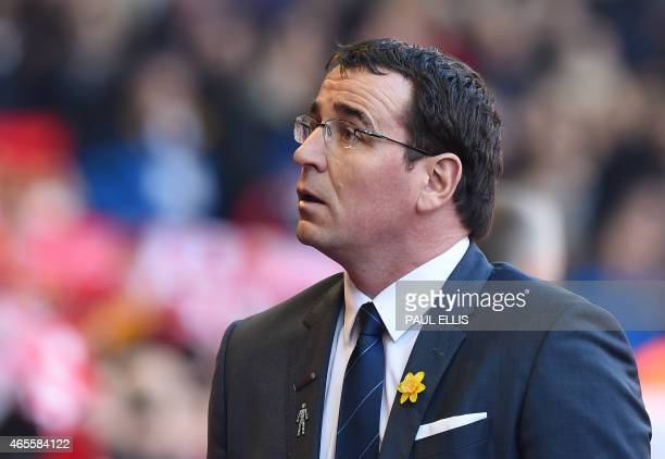 Blackburn's English manager Gary Bowyer arrives for the FA Cup quarterfinal match between Liverpool and Blackburn Rovers at Anfield in Liverpool...