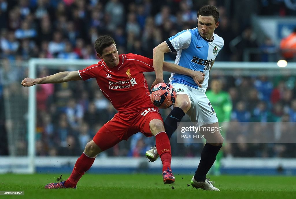 Blackburn's Northern Irish midfielder Corry Evans (R) vies with Liverpool's Welsh midfielder <a gi-track='captionPersonalityLinkClicked' href=/galleries/search?phrase=Joe+Allen+-+Welsh+Soccer+Player&family=editorial&specificpeople=9629091 ng-click='$event.stopPropagation()'>Joe Allen</a> during the English FA Cup quarter-final replay football match between Blackburn Rovers and Liverpool at Ewood Park in Blackburn, north west England on April 8, 2015.