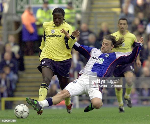 Blackburn's Tugay moves in to tackle Bolton's Bernard Mendy during the FA Barclaycard Premiership match at Ewood Park Blackburn THIS PICTURE CAN ONLY...