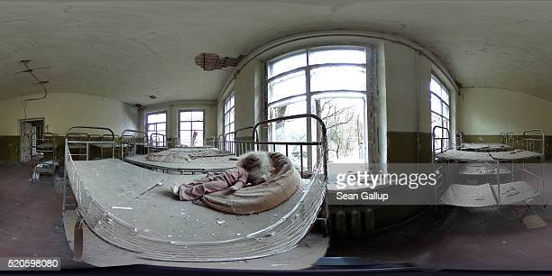 A blackened doll lies on a bed in an abandoned kindergarten on April 9 2016 in Kopachi Ukraine Zalissya once a village of several hundred households...