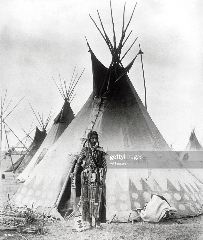 Blackfoot Brave, near Calgary, Alberta, 1889 (b/w photo)