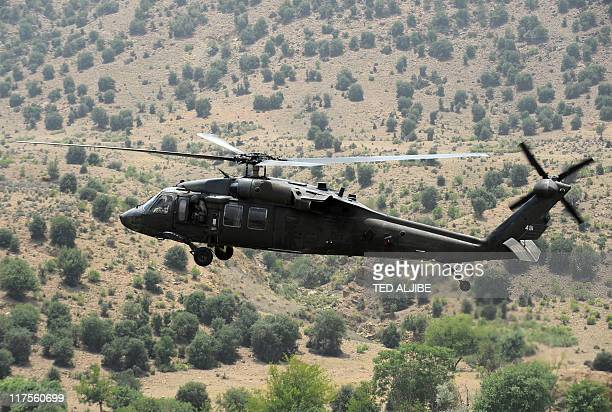 Blackhawk army helicopter flies over the mountainous area of Gorbuz district on the border with Pakistan in Khost province east of Afghanistan on...