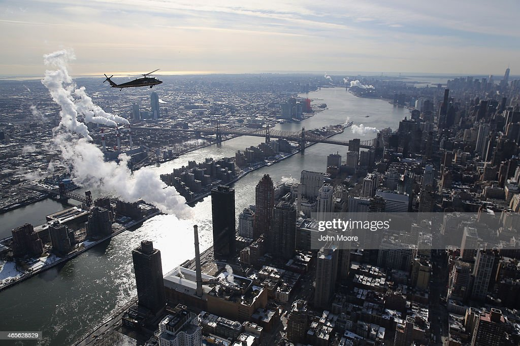 Blackhawk helicopter flown by US Customs and Border Protection flies over the East River and Manhattan in route to the Metlife Stadium on January 28...