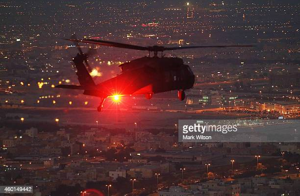 Blackhawk helicopter from Bravo Co 2/147th AVN Renegades flies support for US Secretary of Defense Chuck Hagel December 8 2014 over Kuwait City...
