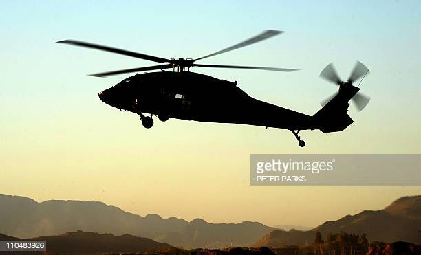 A Blackhawk helicopter from Company C 1st Battalion 52nd Aviation Regiment medevac team lands at Kandahar airbase in southern Afghanistan on March 19...