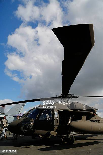 A Blackhawk helicopter produced by Sikorsky a unit of United Technologies Corp stands on display on the second day of the Farnborough International...