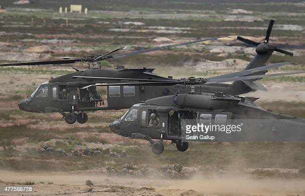 Blackhawk helicopters of the US Army ferry Dutch soldiers participating in the NATO Noble Jump military exercises of the VJTF forces on June 18 2015...