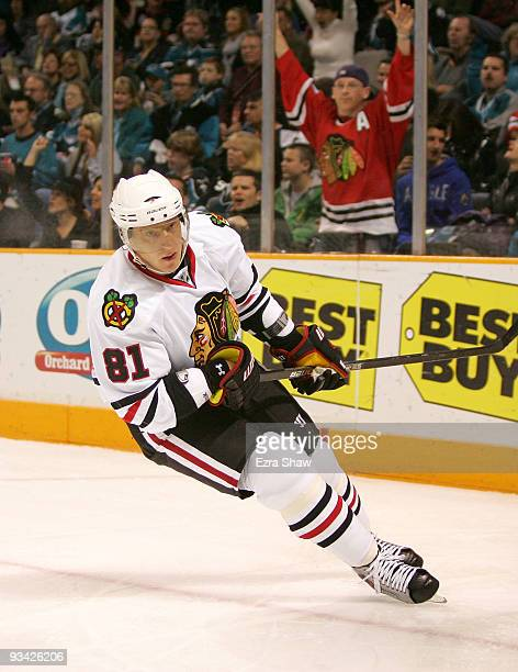 Blackhawks fan celebrates in the background after Marian Hossa of the Chicago Blackhawks scored a shorthanded goal against the San Jose Sharks during...