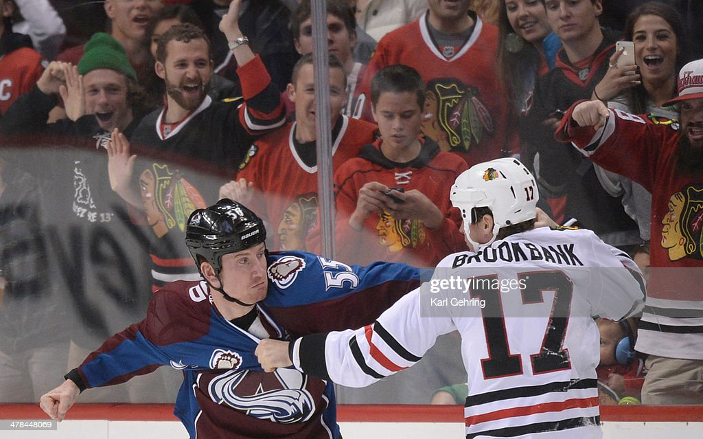 Blackhawks' fans had front row seats for a fight between Cody McLeod and Sheldon Brookbank in the first period. The Colorado Avalanche hosted the Chicago Blackhawks at the Pepsi Center Wednesday night, March 12, 2014 in Denver, Colorado.