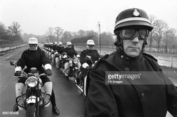 Blackhelmeted Chief Inspector John Baldwin of Traffic Division the team leader of the Special Escort Group of the Metropolitan Police is shown with...