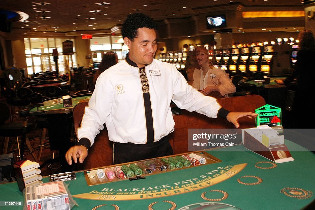 Blackjack dealer Mario Reyes prepares to reopen his table at Caesars Atlantic City July 8, 2006 in Atlantic City, New Jersey. Caesars, along with Atlantic City's 11 other casinos reopend this morning after they were forced to close their gambling floors for the first time in their 28-year history due to the New Jersey state budget impasse.