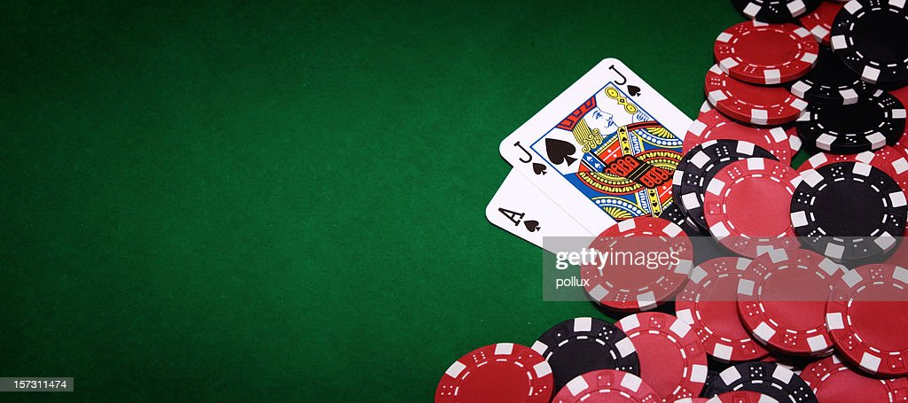 Blackjack table and pile of chips on right side of image : Stock Photo