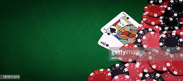 Blackjack table and pile of chips on right side of image