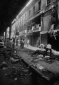 1977 blackout power failure Crews clean up along Broadway between Howard and Gates in Brooklyn an area hard hit by looters This row of stores was...