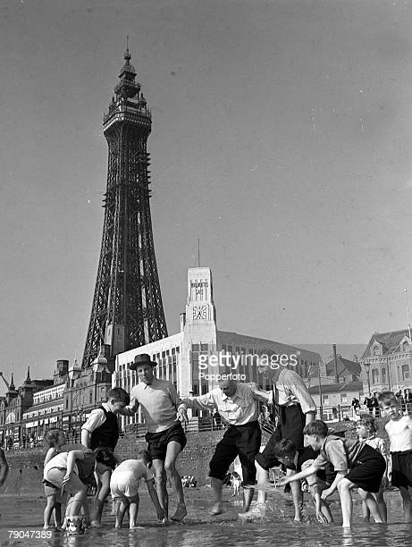 1949 Blackpool England Radio and Stage Stars at Blackpool Children paddling on the beach are joined by three of Britain's best comedians Jimmy Jewell...