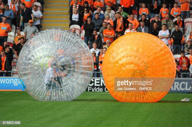 A Blackpool fan and a Fulham fan try their hand at Zorbing on the pitch