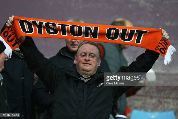 Blackpool fan displays a message for Chairman Karl Oyston during the FA Cup Third Round match between Aston Villa and Blackpool at Villa Park on...