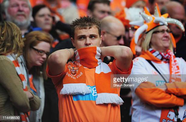 Blackpool fan looks dejected as they are relegated during the Barclays Premier League match between Manchester United and Blackpool at Old Trafford...
