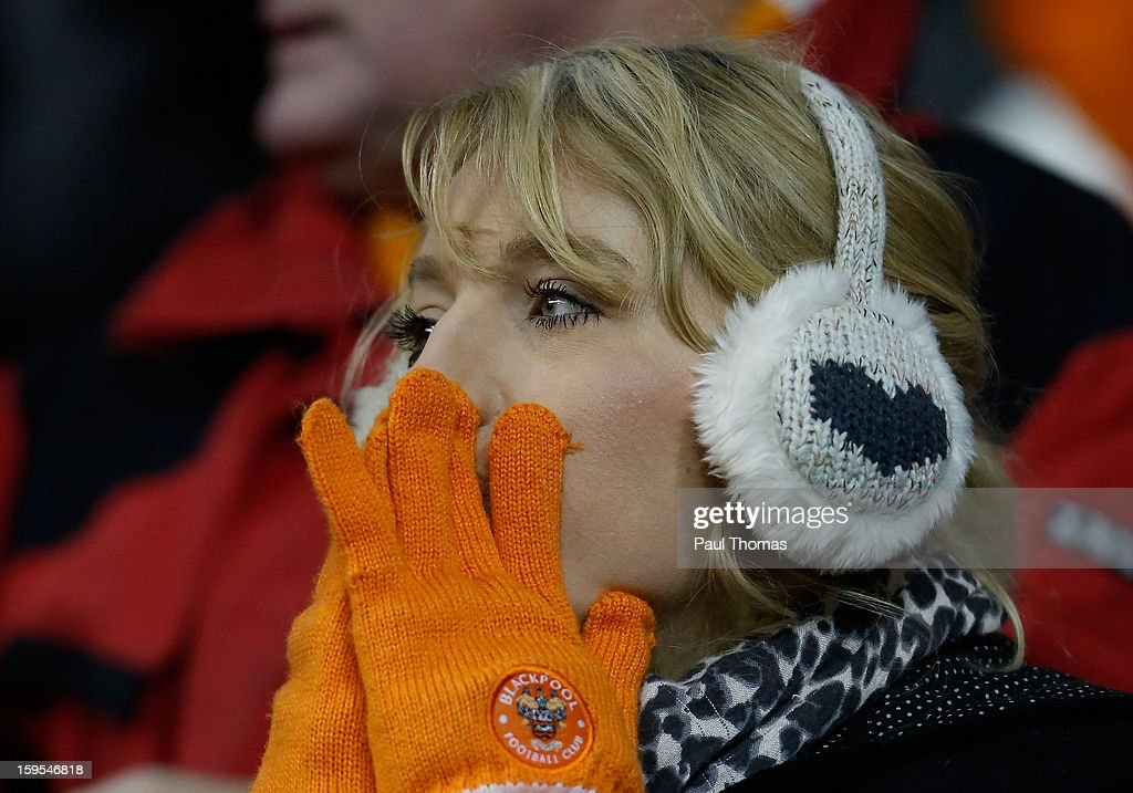 A Blackpool fan reacts during the FA Cup with Budweiser Third Round Replay match between Blackpool and Fulham at Bloomfield Road on January 15, 2013 in Blackpool, England.