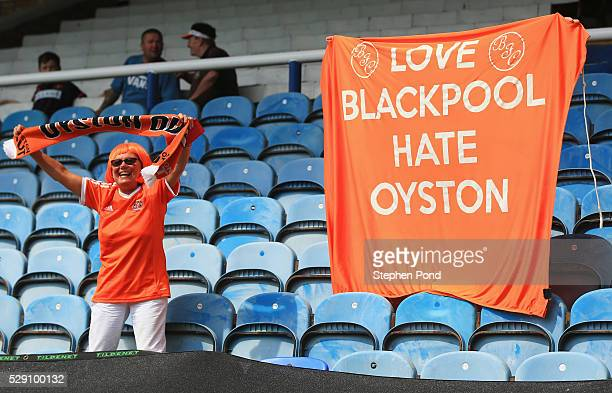 Blackpool fan stands in front of a banner reading 'Love Blackpool Hate Oyston' during the Sky Bet League One match between Peterborough United and...